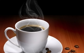 Coffee is a brewed beverage with a dark, acidic flavor prepared from the roasted seeds of the...
