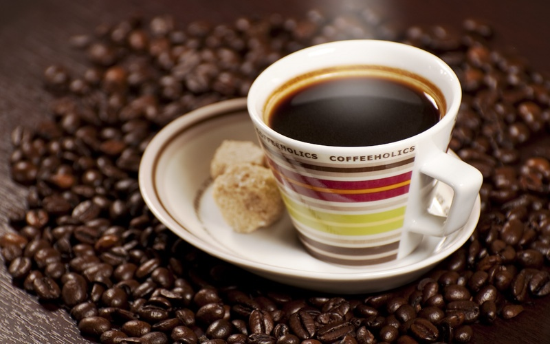 Coffee is a brewed beverage with a dark, acidic flavor prepared from the roasted seeds of...