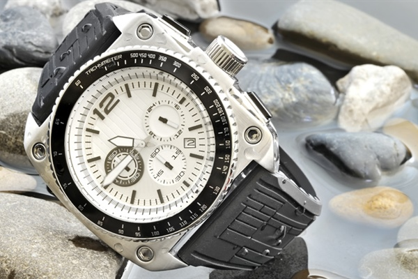 A watch is a small timepiece, typically worn either on the wrist or attached on a chain...