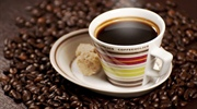 Coffee is a brewed beverage with a dark, acidic flavor prepared from the roasted seeds of the coffee...
