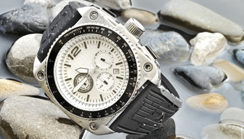 A watch is a small timepiece, typically worn either on the wrist or attached on a chain and...