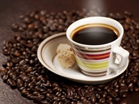 Coffee is a brewed beverage with a dark,...
