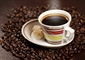 Coffee is a brewed beverage with a dark, acidic flavor prepared...
