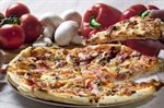 Pizza is an oven-baked, flat, disc-shaped bread typically topped with a tomato sauce, cheese and various toppings.