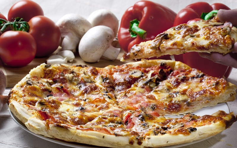 Pizza is an oven-baked, flat, disc-shaped bread typically topped with a tomato sauce,...